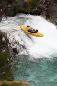 Person-in-a-kayak-in-a-waterfall-Voss